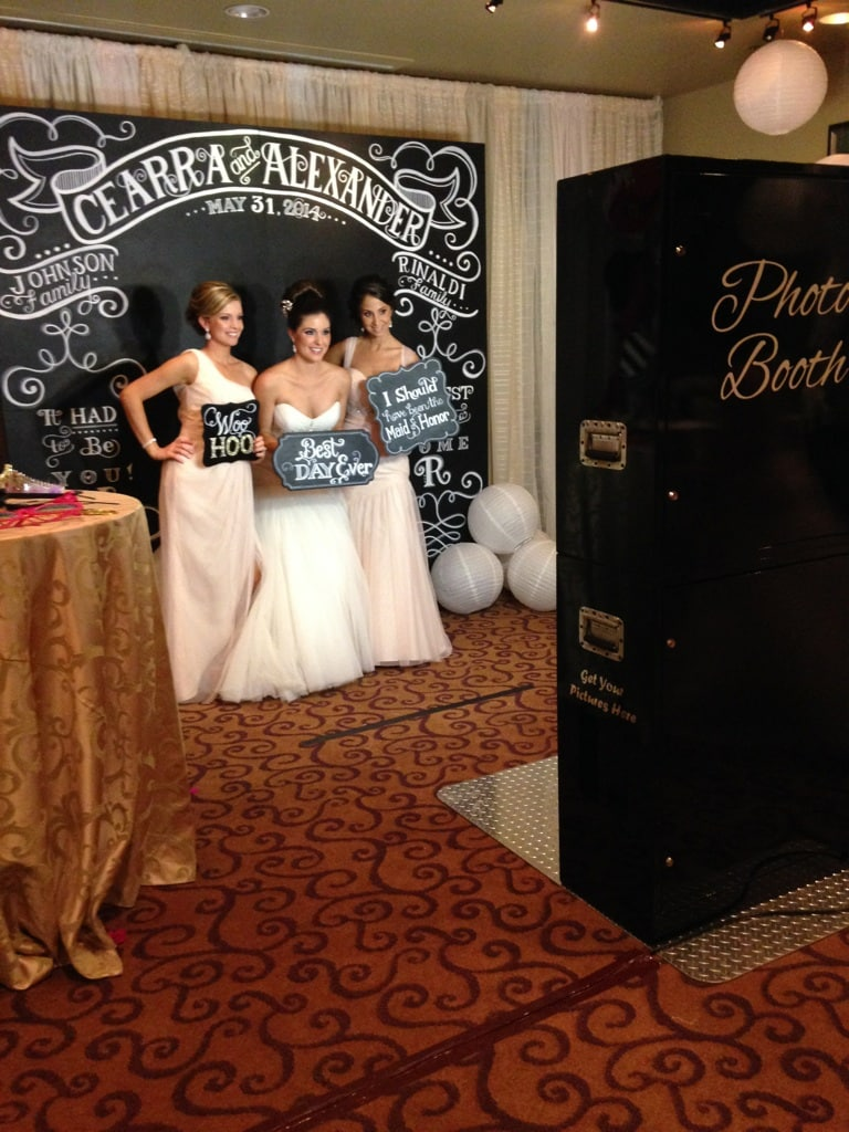 bride in front of custom chalkboard photo booth backdrop